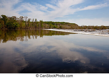River Potomac in broad reflective view prior to the first dam on the river at Great Falls