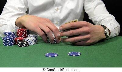 Placing a bet - Poker player placing a bet