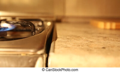 Placing a pan on a gas oven