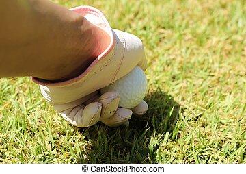 Placing golf ball on a tee