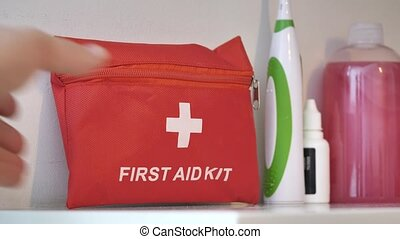 Placing First aid kit placed on shelf in case of injury at home or at work