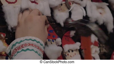 Placing Santa Claus craftwork into Christmas collection