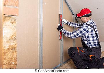 placoplâtre, niveau, grenier, contre, tenue, drywall., intérieur, rénovation, homme
