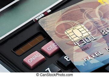 visa chip plastic card over business calculator