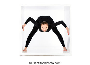Modern bellet dancer posing with a cube at studio. Plastic body concept. Isolated over white.