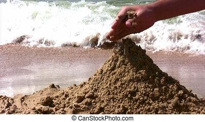 plage sable, jouer, main