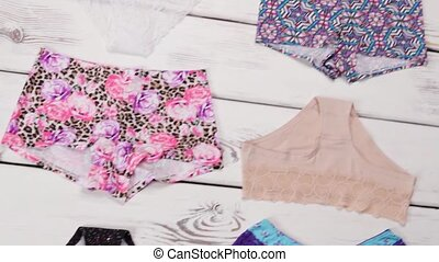 Plain and floral panties. Fashionable lingerie on white...