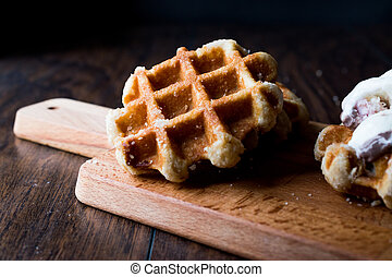 Plain Belgium Waffle on wooden surface.