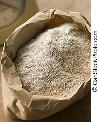 Plain flour in paper bag
