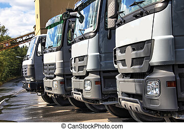plain grey trucks in a row