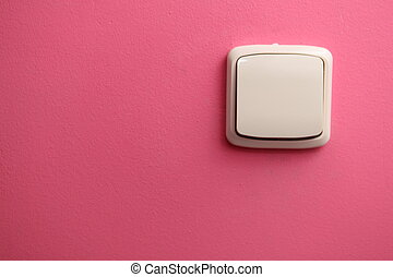 plain pink background with switch