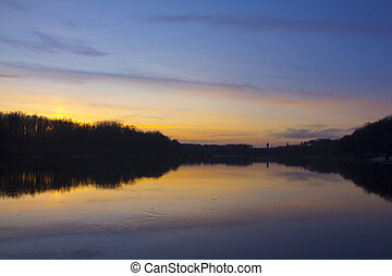 Plain river in the fall after sunset.
