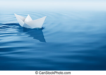 plain sailing - paper boat sailing on blue water surface