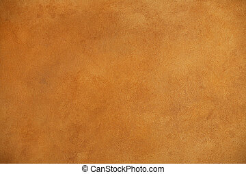 background of a warm brown wall with rough plaster texture