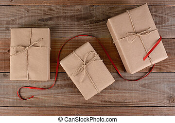 Plain Wrapped Christmas Presents - High angle shot of three...