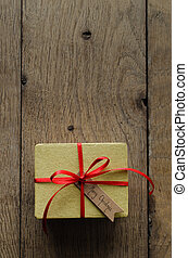 Plain Yellow Gift Box with Red Ribbon and Vintage Style Christmas Tag