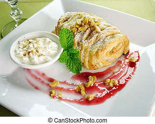 Delicious fresh baked plaited apple pie with walnuts and creamed cottage cheese.