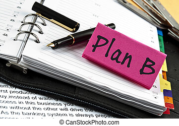 Plan B note on agenda and pen