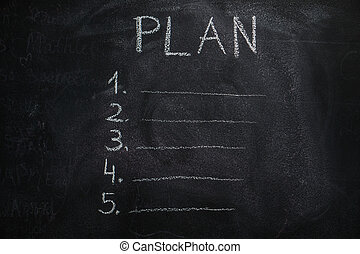 Plan list on black chalkboard