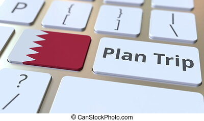 PLAN TRIP text and flag of Bahrain on the computer keyboard,...