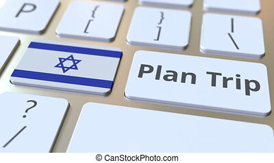 PLAN TRIP text and flag of Israel on the computer keyboard,...