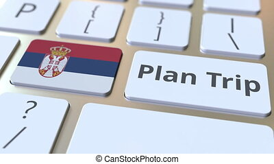 PLAN TRIP text and flag of Serbia on the computer keyboard,...