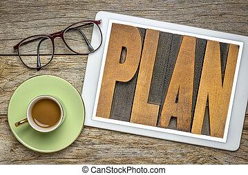 plan word in letterpress wood type on tablet
