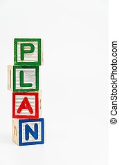 PLAN word wooden block arrange in vertical style on white background and selective focus