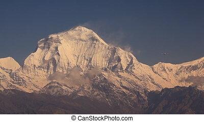 Plane Aircraft Snow Peak - Plane flies against Dhaulagiri...