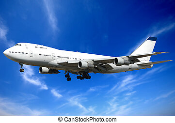 Jumbo jet plane and blue and clouds.