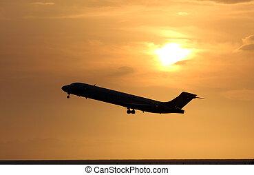 plane take off against sun