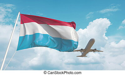 Plane arrives to airport with flag of Luxembourg. ...