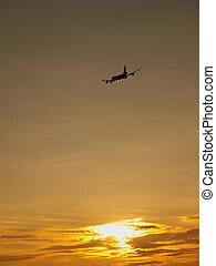Plane at sundown