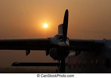 Plane at sunrise in Kathmandu airport, Nepal