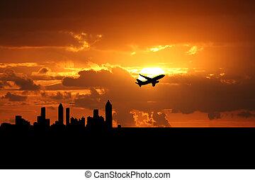 plane departing Atlanta at sunset illustration