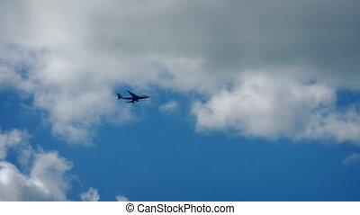 Plane Flies Across Blue Sky - 747 High above flies over on...