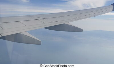 Plane flies over the water surface. The pond is a top view
