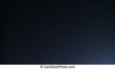 Plane flies overhead at night (1 of 3)