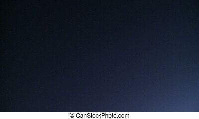 Plane flies overhead at night (2 of 3)
