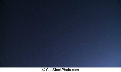 Plane flies overhead at night (3 of 3)