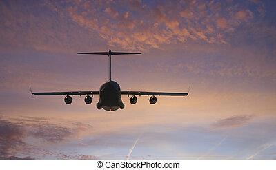 Plane Flies Towards Sunset