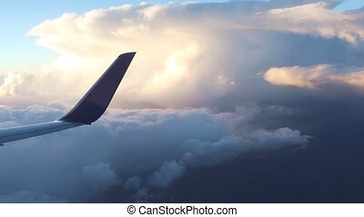 Plane flight above the clouds - Wing of an airplane flying...