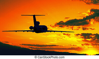 Plane fly to sunset
