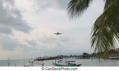 Plane Flying Close Over Head and Landing Nearby at Samui island, Thailand.