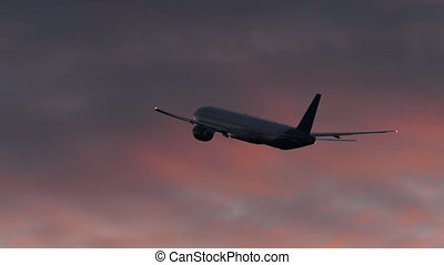 Plane flying in evening cloudy sky - Airplane flying and...