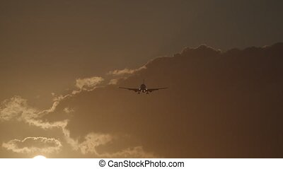 Plane flying in sky with warm evening light