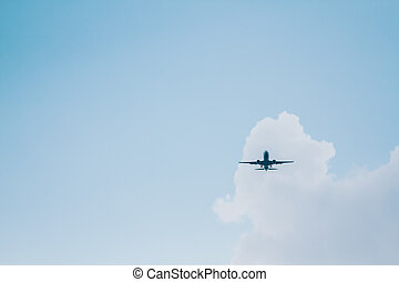 Plane Flying on Blue Cloudy Sky