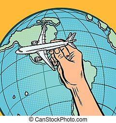 plane in hand. metaphor of flying to America
