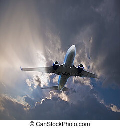 Plane in the stormy sky.