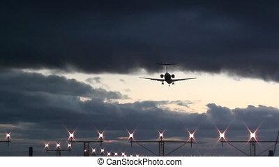 plane landing at dusk